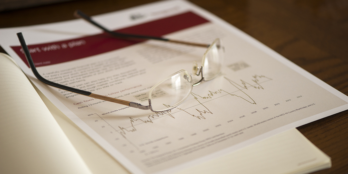 Eye glasses sitting on a report