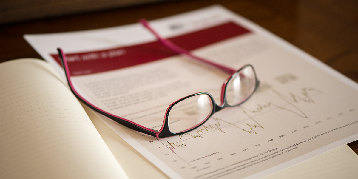Glasses sitting atop papers